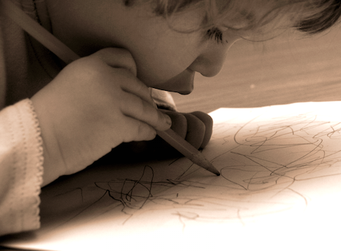 Child working on art as Play Therapy