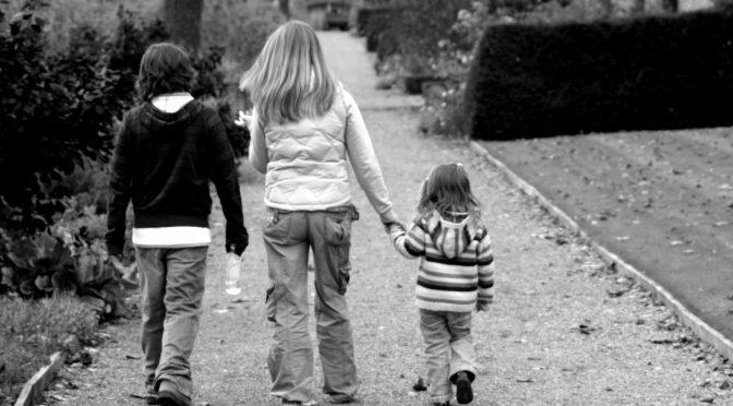 Children walking towards house